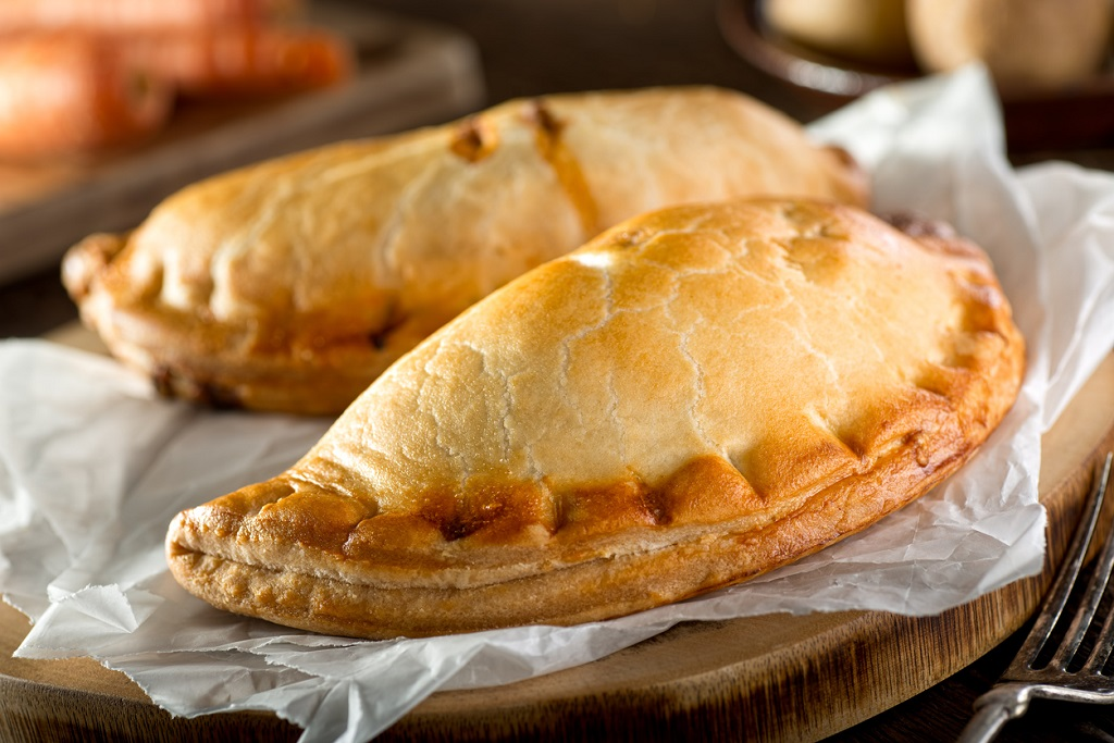 Delicious homemade Cornish pasties with beef, carrot, and potato. Cornish food