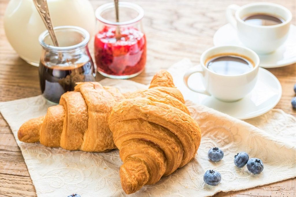 Croissants with cups of coffee and milk France