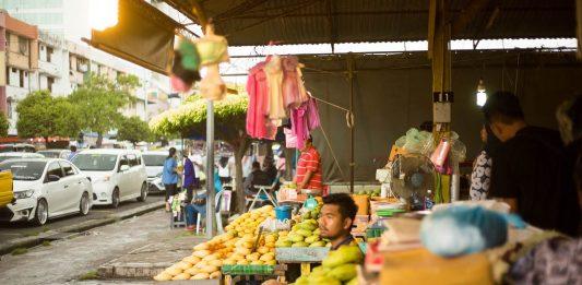 A fruit vendor in Sabah market