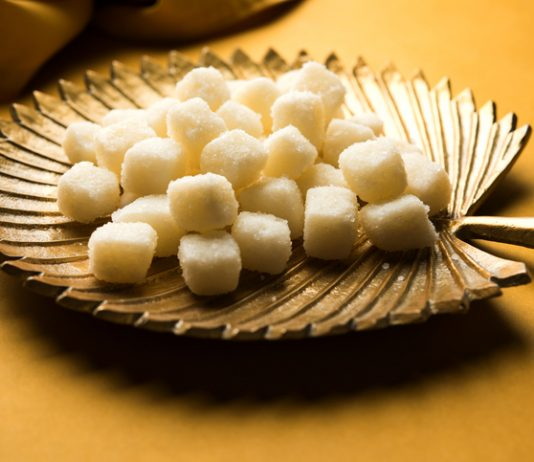 Bengali Sweet Chena Murki served in a golden plate