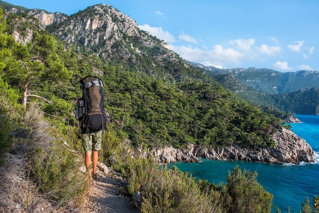 Hiking in Turkey. Lycian Way. Backpacker by the sea. The track is completed, Hiking Shoes