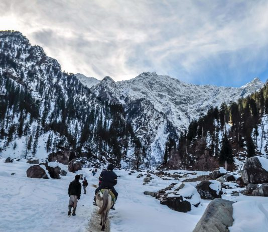 trekkers going up a snow covered path - reasons to go trekking