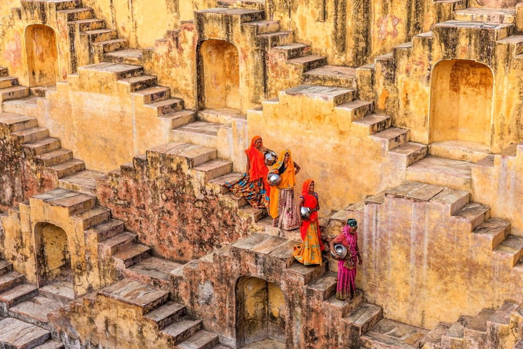 Indian women carrying water from stepwell near Jaipur, Rajasthan