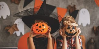 Children playing with Halloween decoration -Halloween in the USA