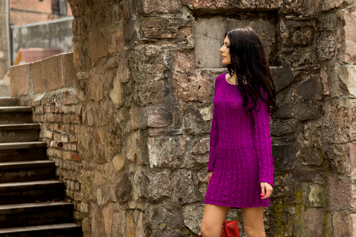 The beauty in a bright knitted dress