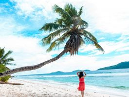 A girl on the Anse Fourmis Beach, Seychelles - Budget guide to Seychelles