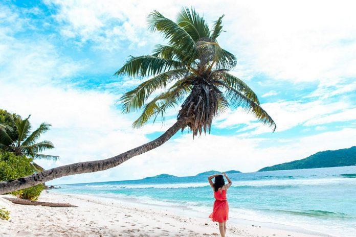 A girl on the Anse Fourmis Beach, Seychelles - Budget guide to Seychelles
