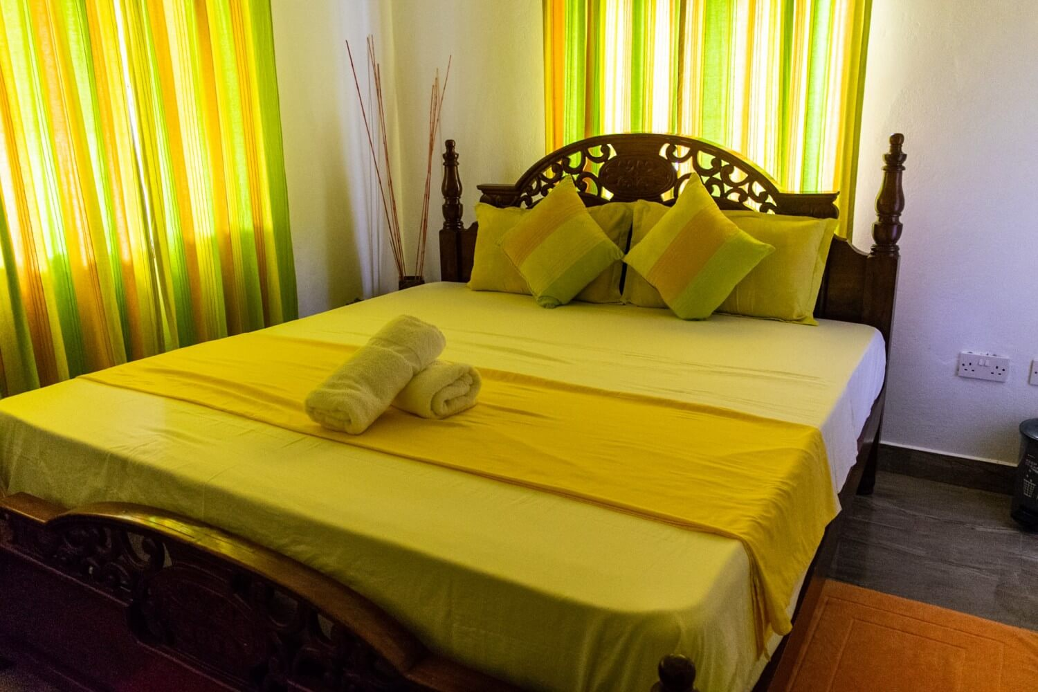 A bed in a Self Catering Apartment - budget guide to Seychelles