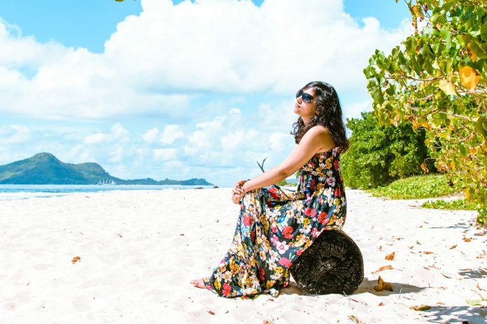 A woman relaxing on a beach in Seychelles