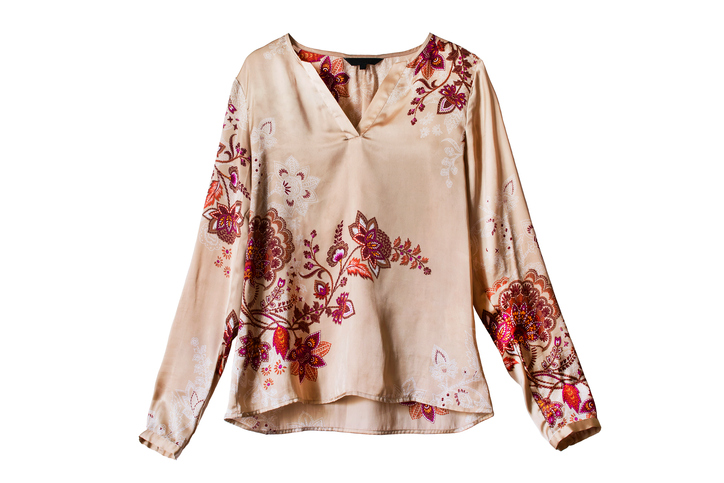 Silk ethnic ornamental blouse isolated over white - travel outfits for women