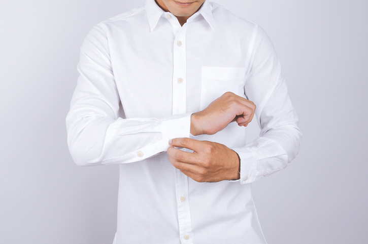 man wearing a white button-down shirt for travel outfits for men