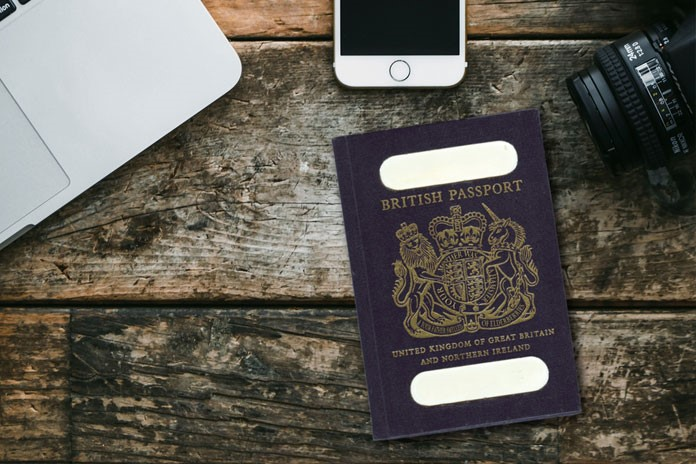 Passport on a wooden table - travelling to Pakistan
