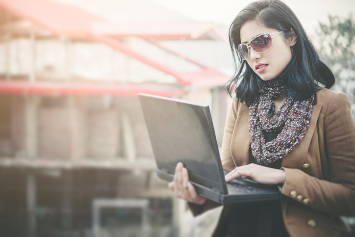 Brown blazer with printed scarf and sunglasses for an office look