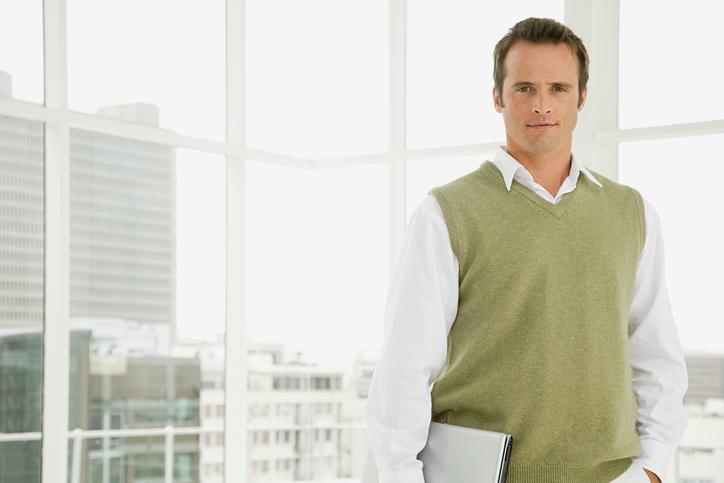 A man in a sleeveless sweater - Men's business travel wardrobe