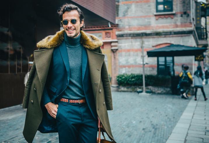 Elegant gentleman wearing a high neck sweater - men's business travel wardrobe
