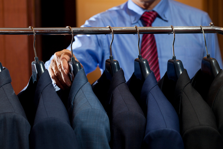 selection of suits - men's business travel wardrobe