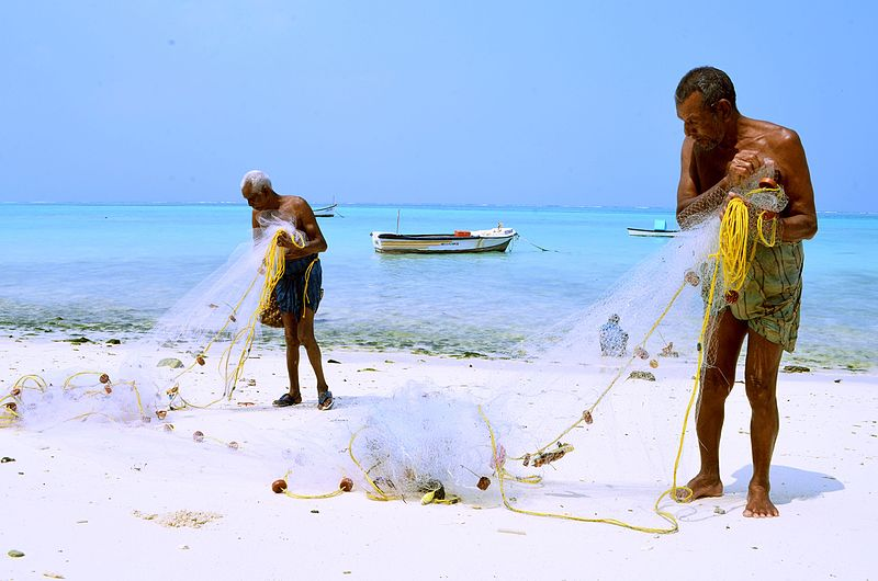 Two fishermen at work on the islands of lakshadweep