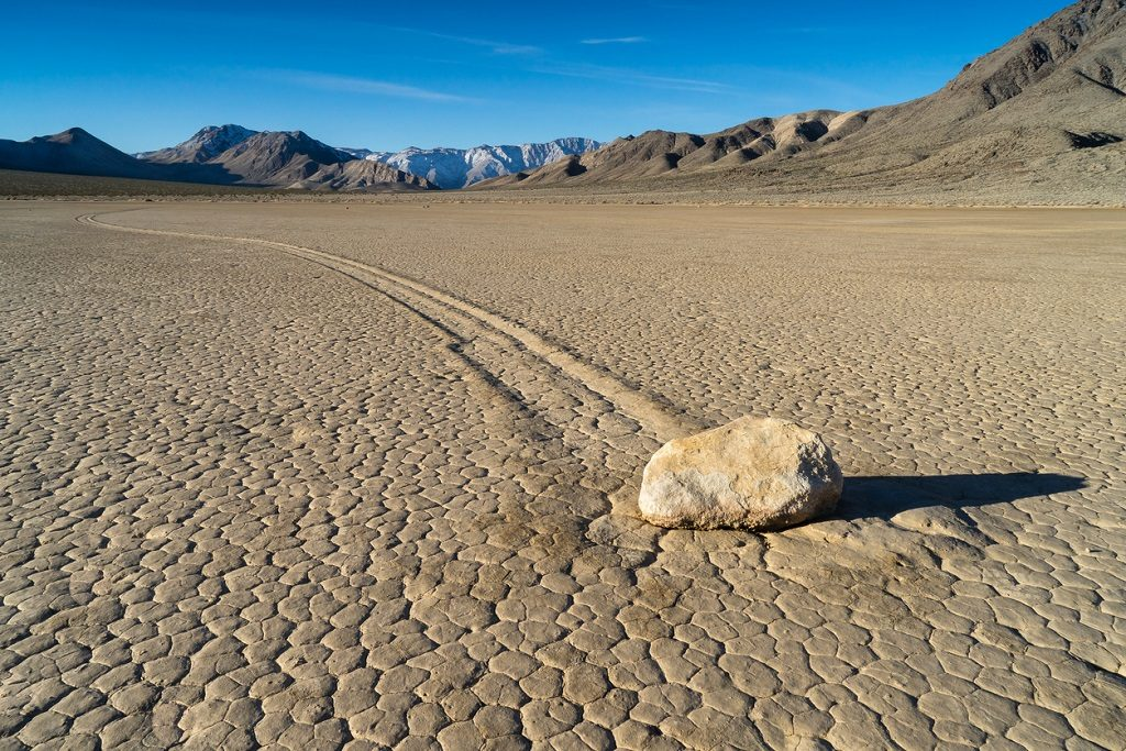 "The Racetrack Playa, or The Racetrack, is a scenic dry lake feature with ""sailing stones"" that inscribe linear ""racetrack"" imprints. It is located above the northwestern side of Death Valley, in Death Valley National Park, Inyo County, California, U.S."