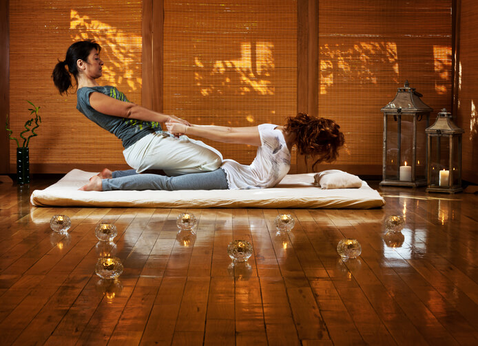 Woman receiving Traditional Thai massage