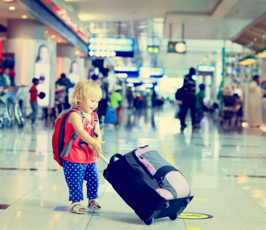 little girl with suitcase at the airport, kids travel