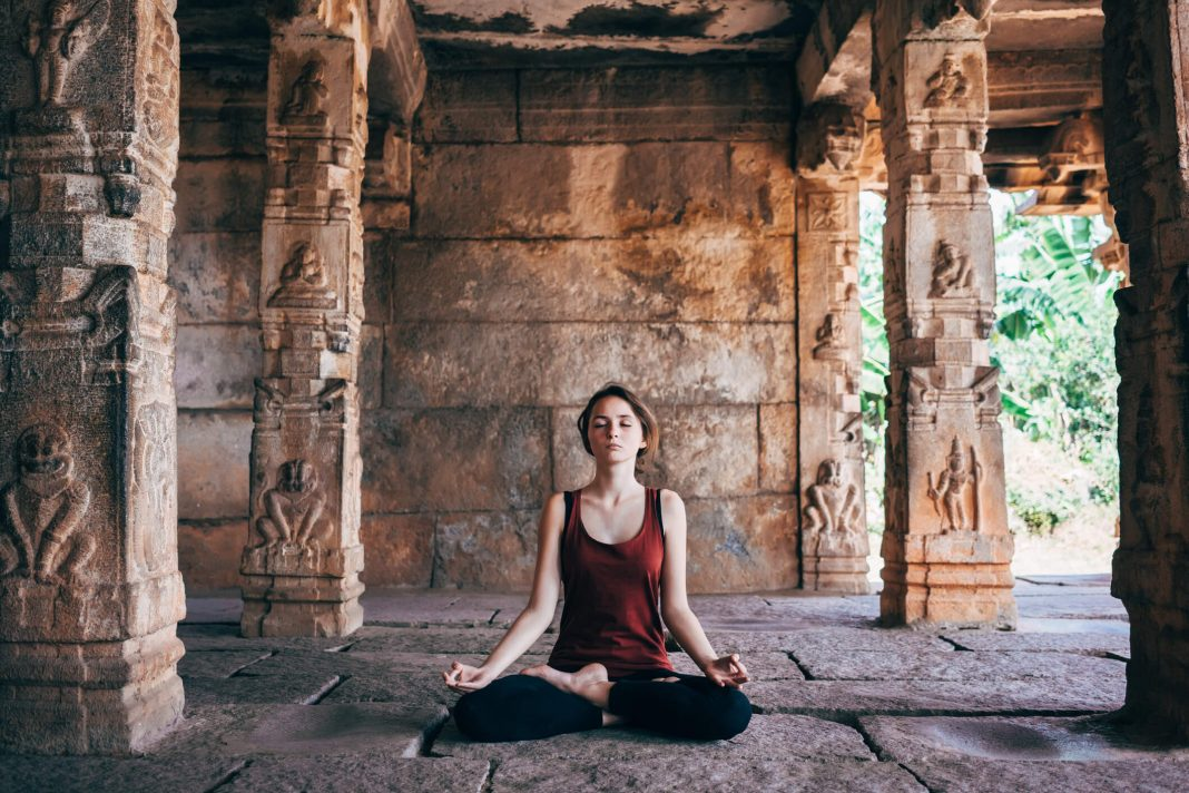 The practice of Asanas, Paranayama and Meditation