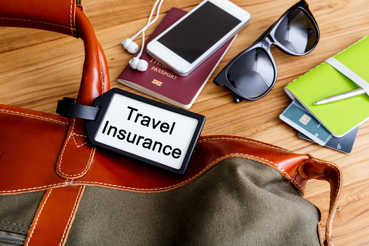 Travel insurance tag on luggage - travel Insurance policies