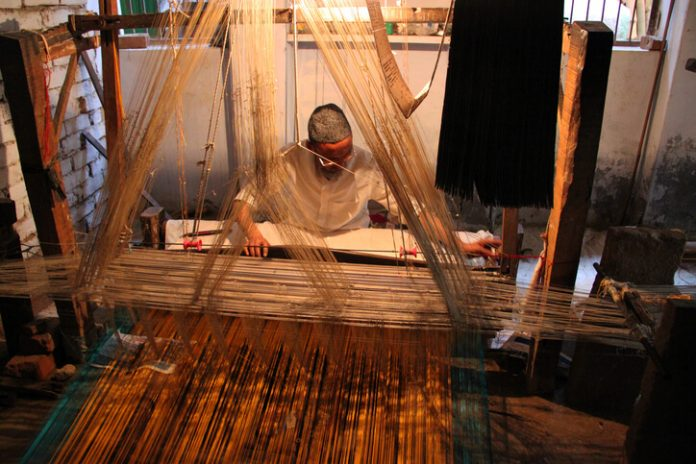 A man working at a Silk loom in Varanasi