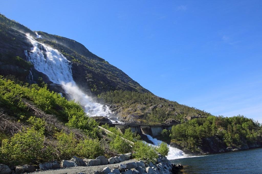 View on Langfossen Langfoss waterfall in summer, Etne, Norway