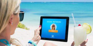 Woman using social network website on digital tablet