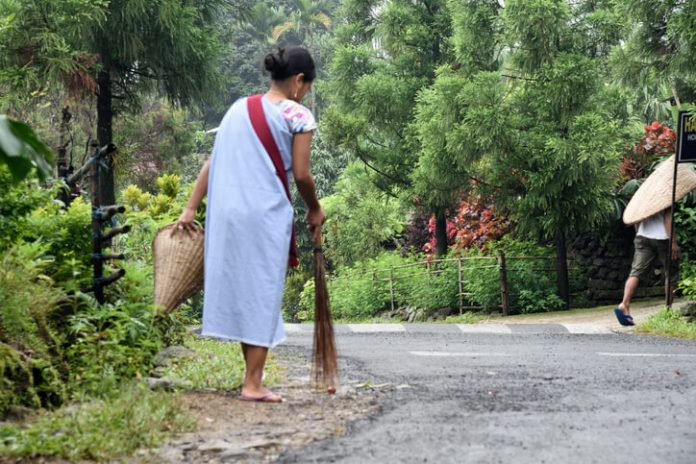 Woman cleaning the road in Meghalaya