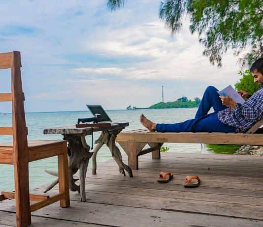 Man sitting on a deck chair on Macan Island, Jakarta Indonesia