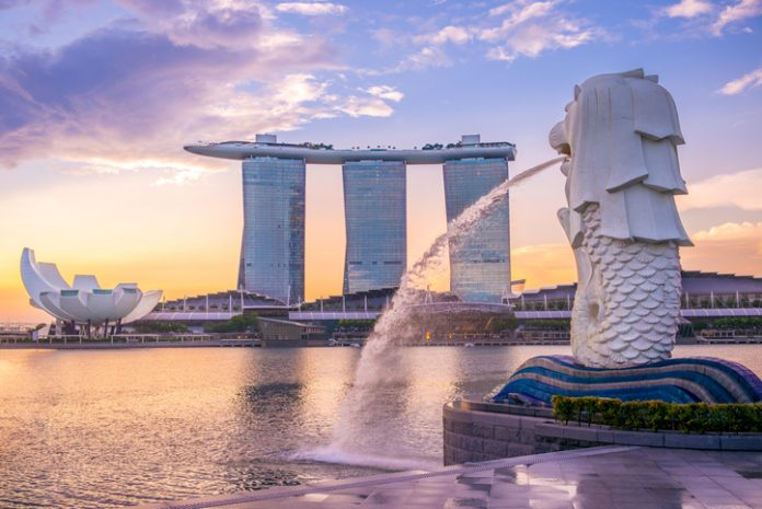 Silhouette of Merlion Statue at Marina Bay against the sunrise. Merlion is a well known marketing icon of Singapore