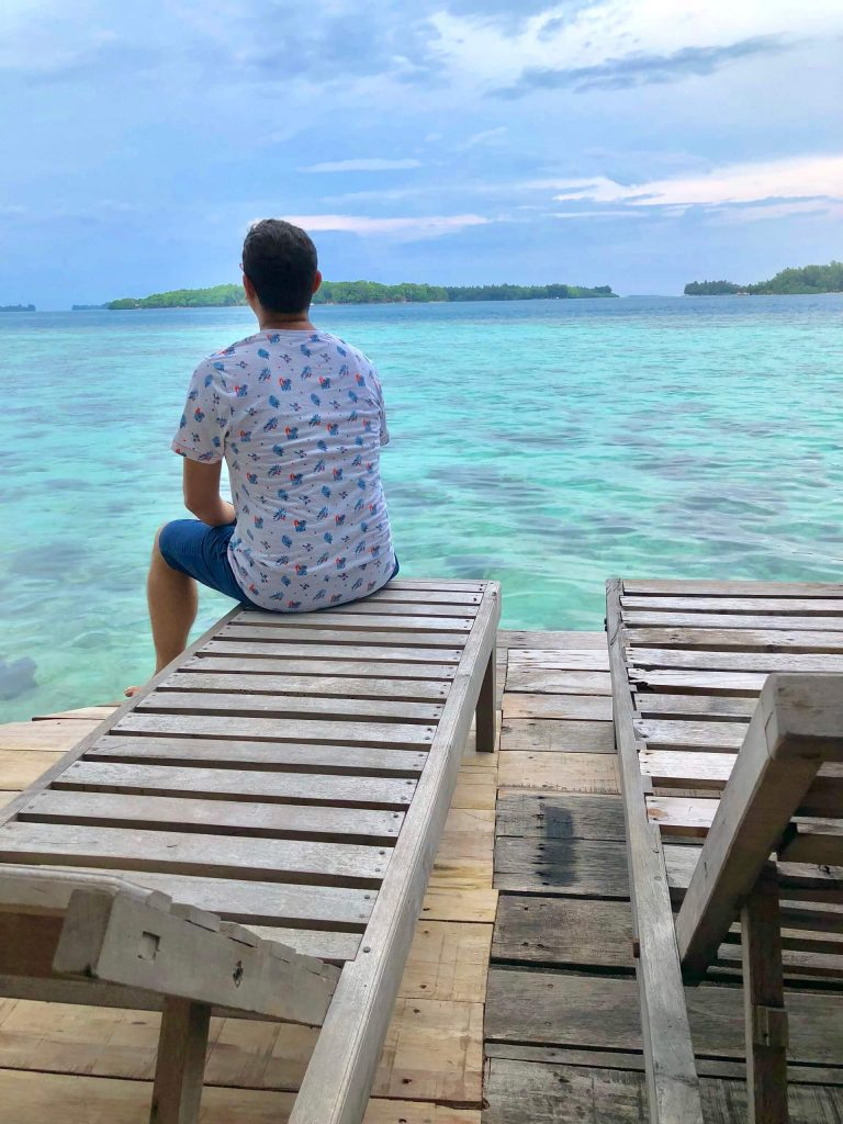 Man on the deck of Pulau Macan (Tiger Island)
