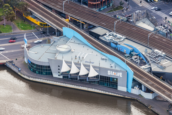 Aerial view of Melbourne Sea Life Aquarium building on the bank of Yarra River