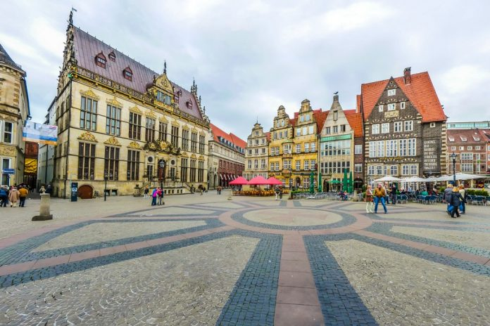 Ancient Bremen Market Square in the centre of the Hanseatic City of Bremen with view on The Schuetting (former guild house) and famous Raths-Buildings, Germany