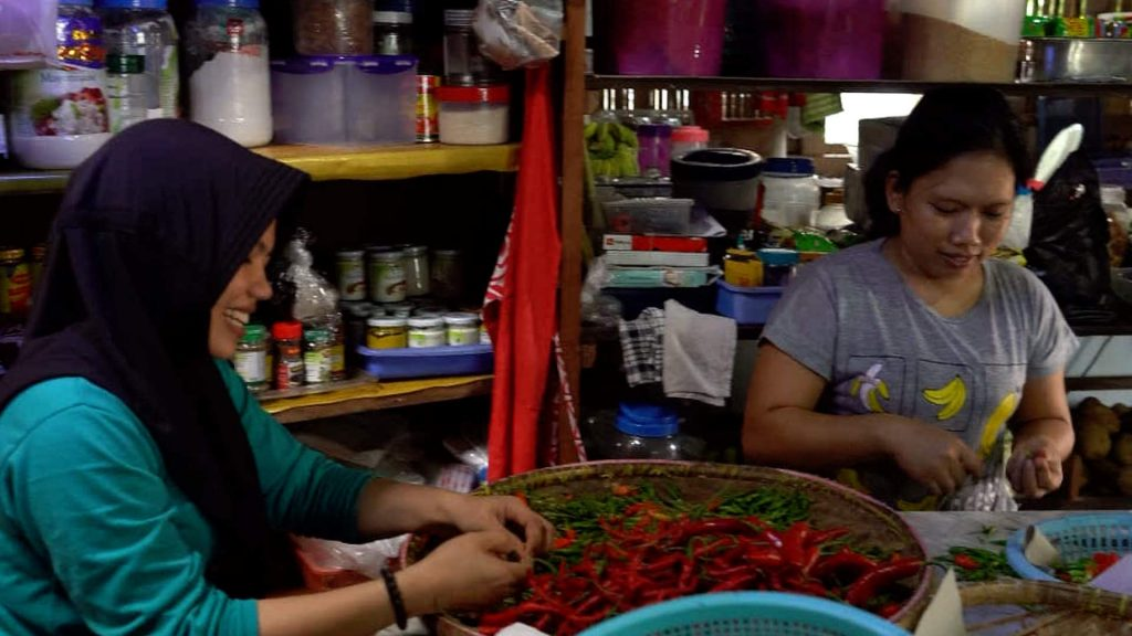 Indonesian women chopping chillies