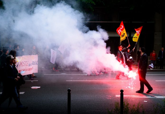 Paris, France - May 12, 2016 - French unions and students protest in Paris, France after the government forced through controversial labour reforms. | Source: Unsplash