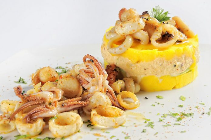 Causa stuffed with seafood, a typical dish of Peru.