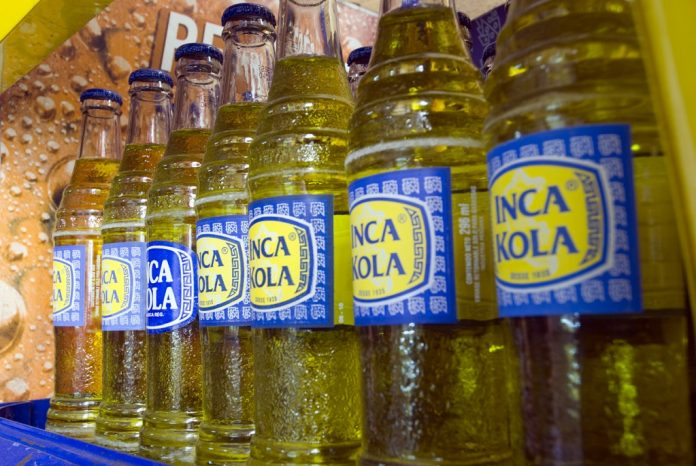 Lima, Peru - February 22th, 2011: Bottles of Inca Kola, a peruvian soft drink. It is a sweet and fruity flavored soda, sometimes compared to liquid bubblegum.