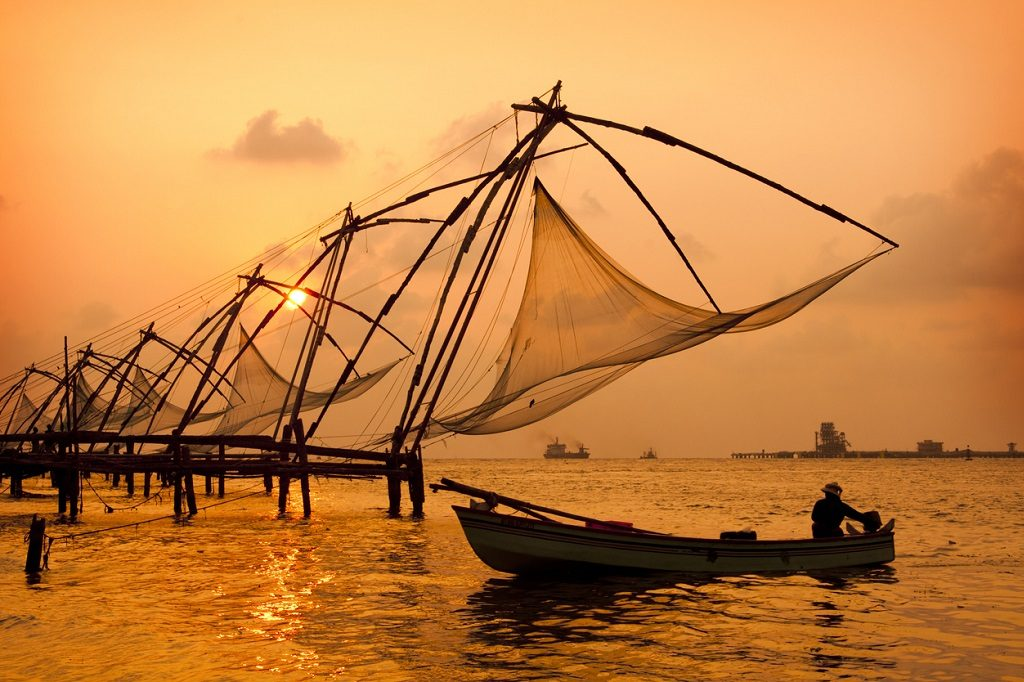 Sunset over Chinese Fishing nets and boat in Cochin (Kochi), Kerala, India.Sunset over Chinese Fishing nets and boat in Cochin (Kochi), Kerala, India.