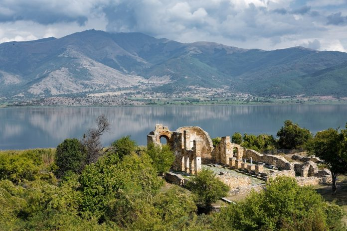 Landscape with the ruins of the Basilica of Agios (Saint) Achillios at the Small Prespa Lake in northern Greece