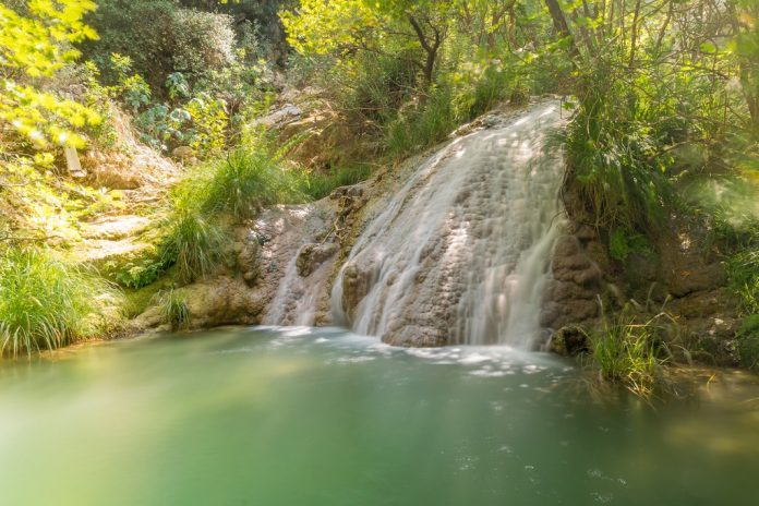 Waterfall at Polilimnio in Greece. A touristic destination.