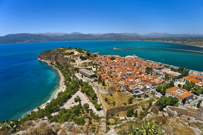 Greece. Nafplio. Aerial view of the old part of the city from Palamidi castle. There is Bourtzi Castle in background
