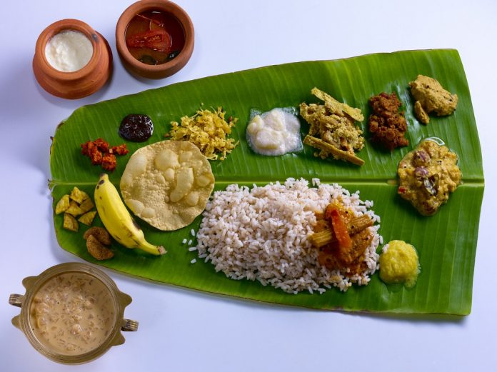 Traditional Onam sadya served in banana leaf. Visit kerala