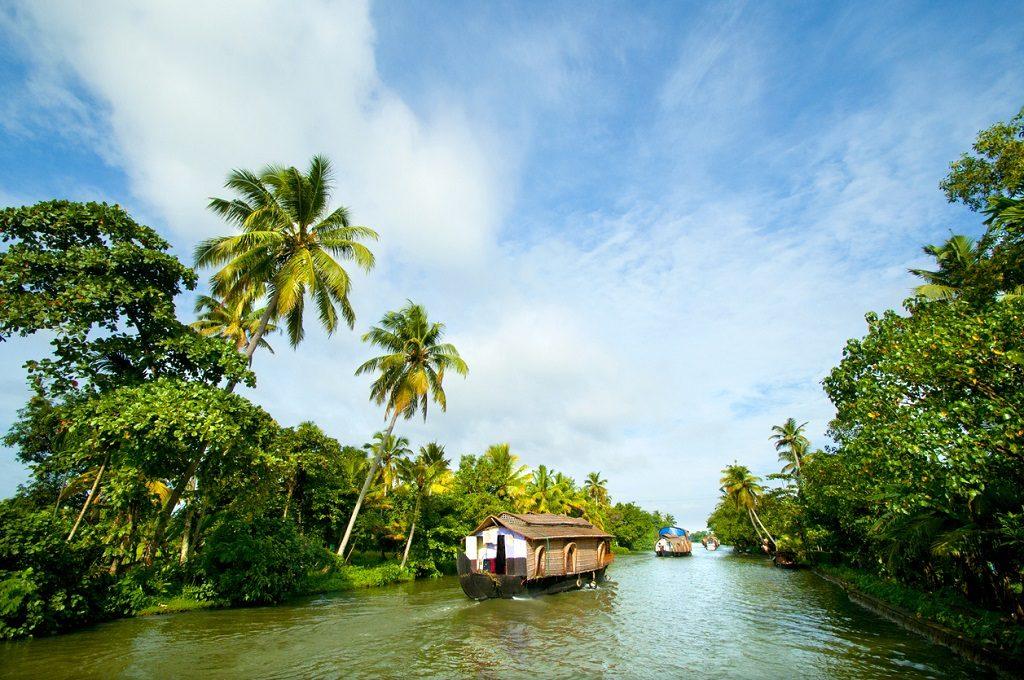 houseboat cruise through the backwaters, kerala tourism, Tourist Spots In Kerala