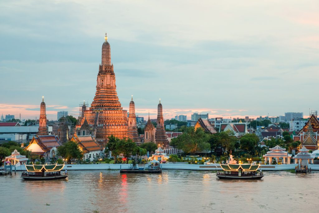 Wat Arun and cruise ship in night ,Bangkok city ,Thailand most visited cities