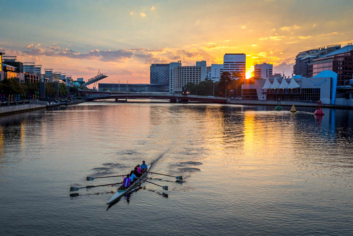 People kayaking at sunset on the Yarra river in Melbourne city center, Australia