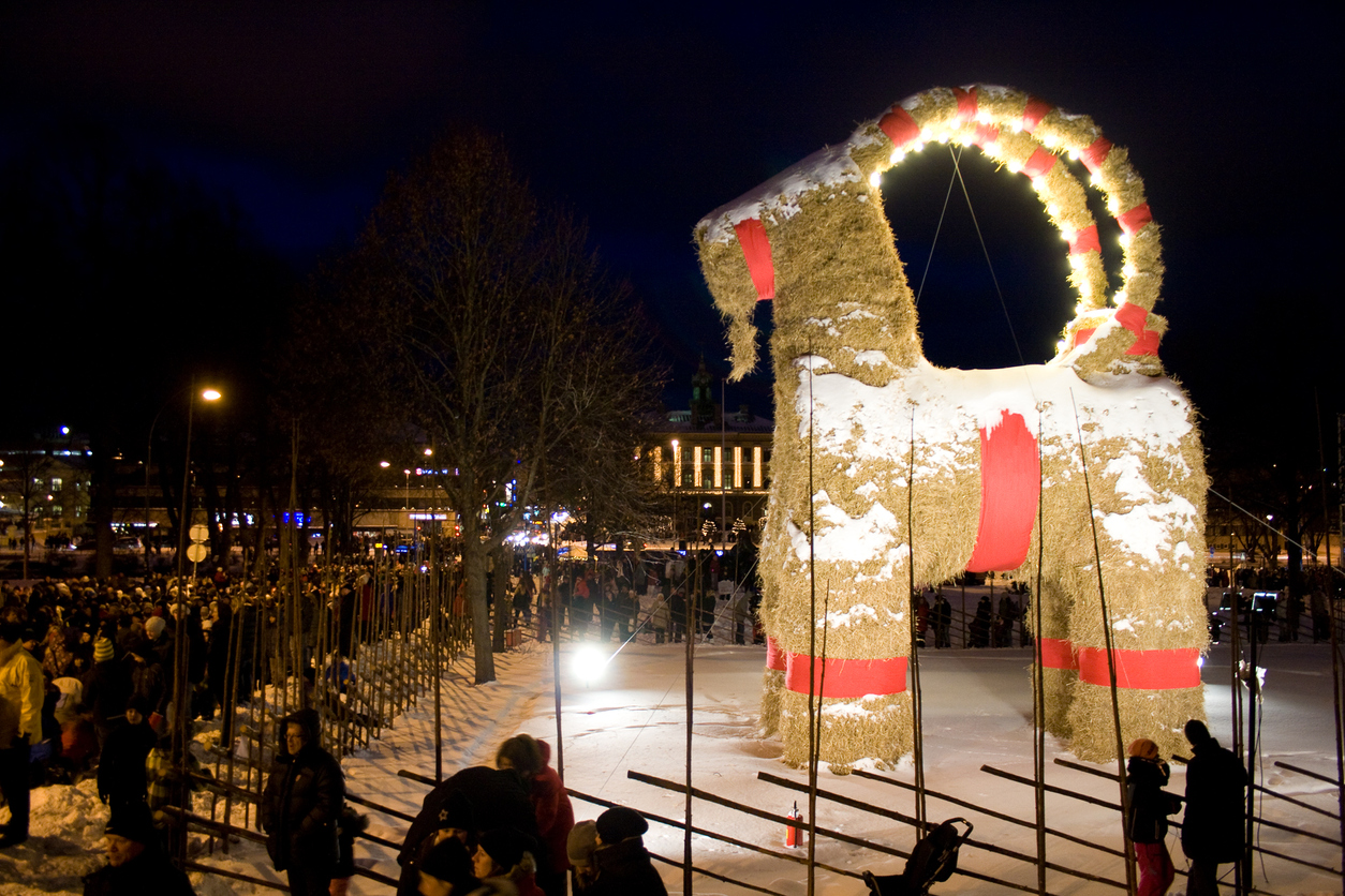 The GAvle Christmas Goat standing near the city Library and river in GAvle, Sweden on it's inauguration night in 2010. The GAvle Goat is a massive version of a traditional Scandinavian Cristmas symbol, the straw goat. The GAvle Goat is built annually some months before Christmas and it has a notorious history of being burnt down by saboteurs.""