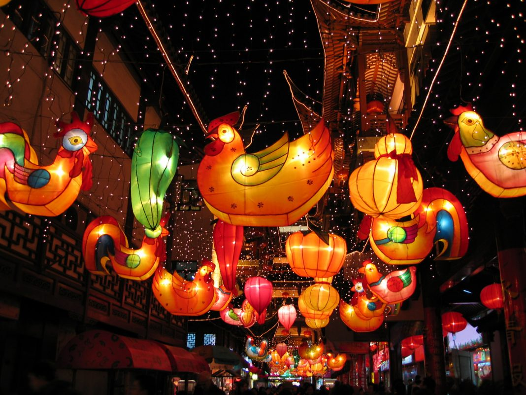 In old town Shanghai the evenings are festive with bright, colorful paper lanterns hanging overhead. This photo was taken in the Chinese year of the cock. While often called