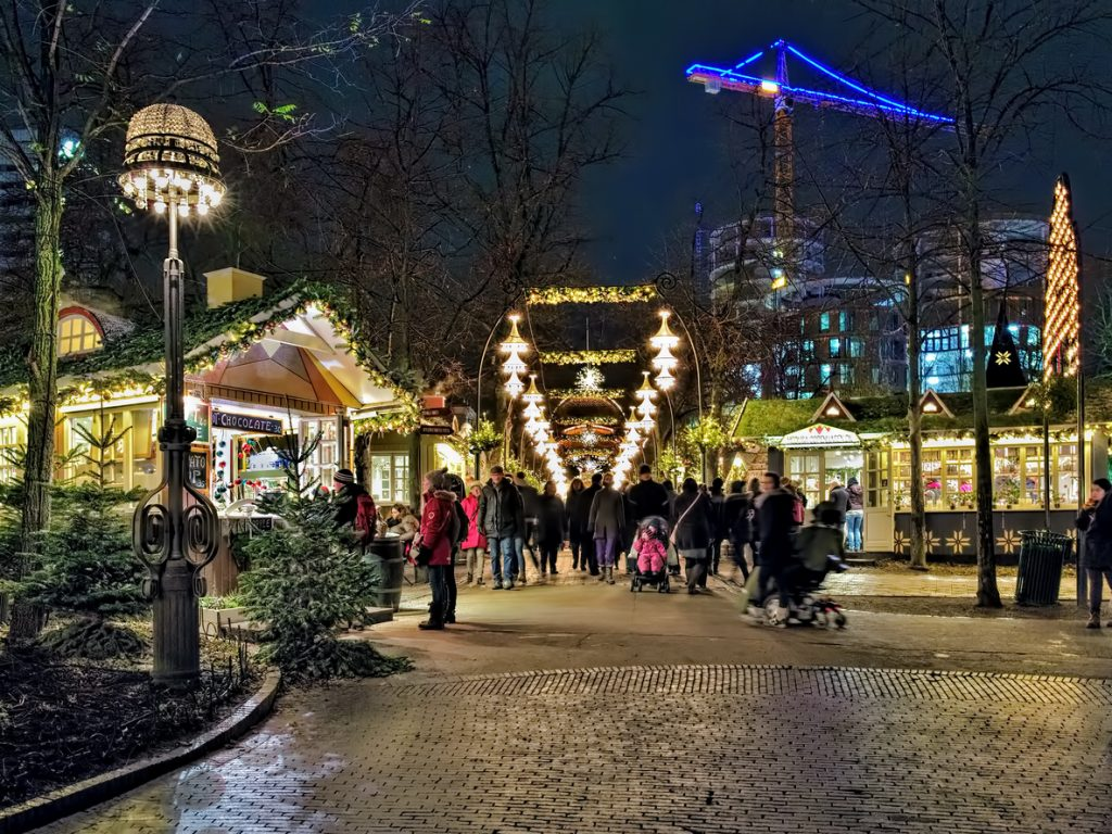 Copenhagen, Denmark - December 14, 2015: Christmas market in Tivoli Gardens in dusk. Tivoli Gardens is a famous amusement park and pleasure garden; it is the most-visited theme park in Scandinavia.